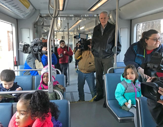 Milwaukee Mayor Tom Barrett rides The Hop on Monday with children from Ebenezer Child Care to kick off Family Hop Week.