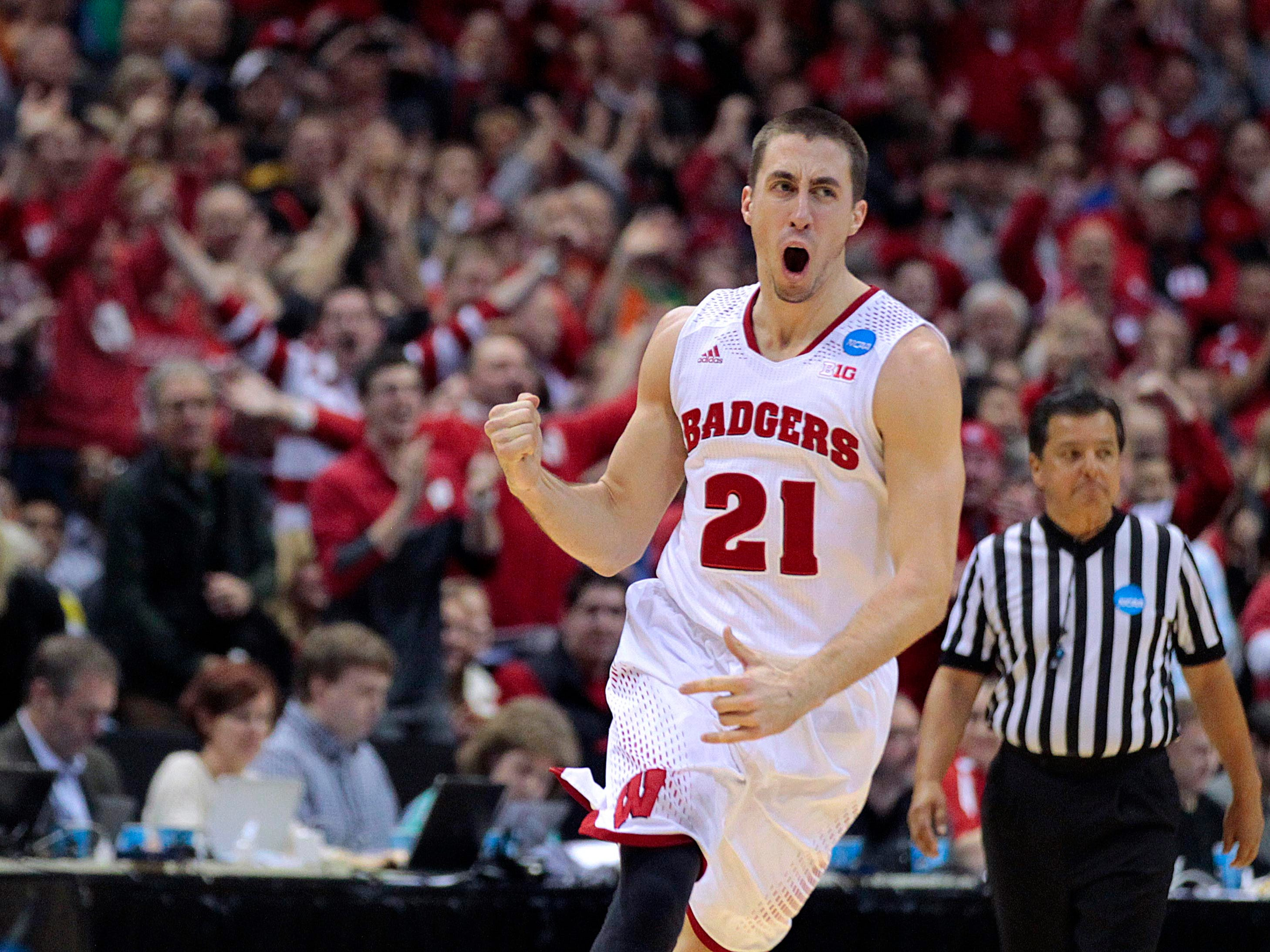 Wisconsin Badgers guard Josh Gasser (21) celebrates in the final minute during Wisconsin's 85-77 win over Oregon during he  third round of the NCAA Men's Basketball Championship between Wisconsin and Oregon at the BMO Harris Bradley Center in Milwaukee, Wisconsin, Saturday, March 22, 2014.