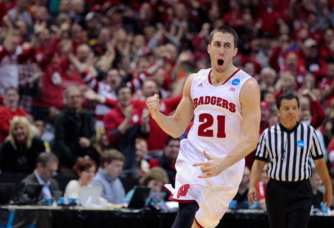 Wisconsin Badgers guard Josh Gasser celebrates in the final minute during Wisconsin's 85-77 win over Oregon during he third round of the 2014 NCAA Tournament at the BMO Harris Bradley Center.