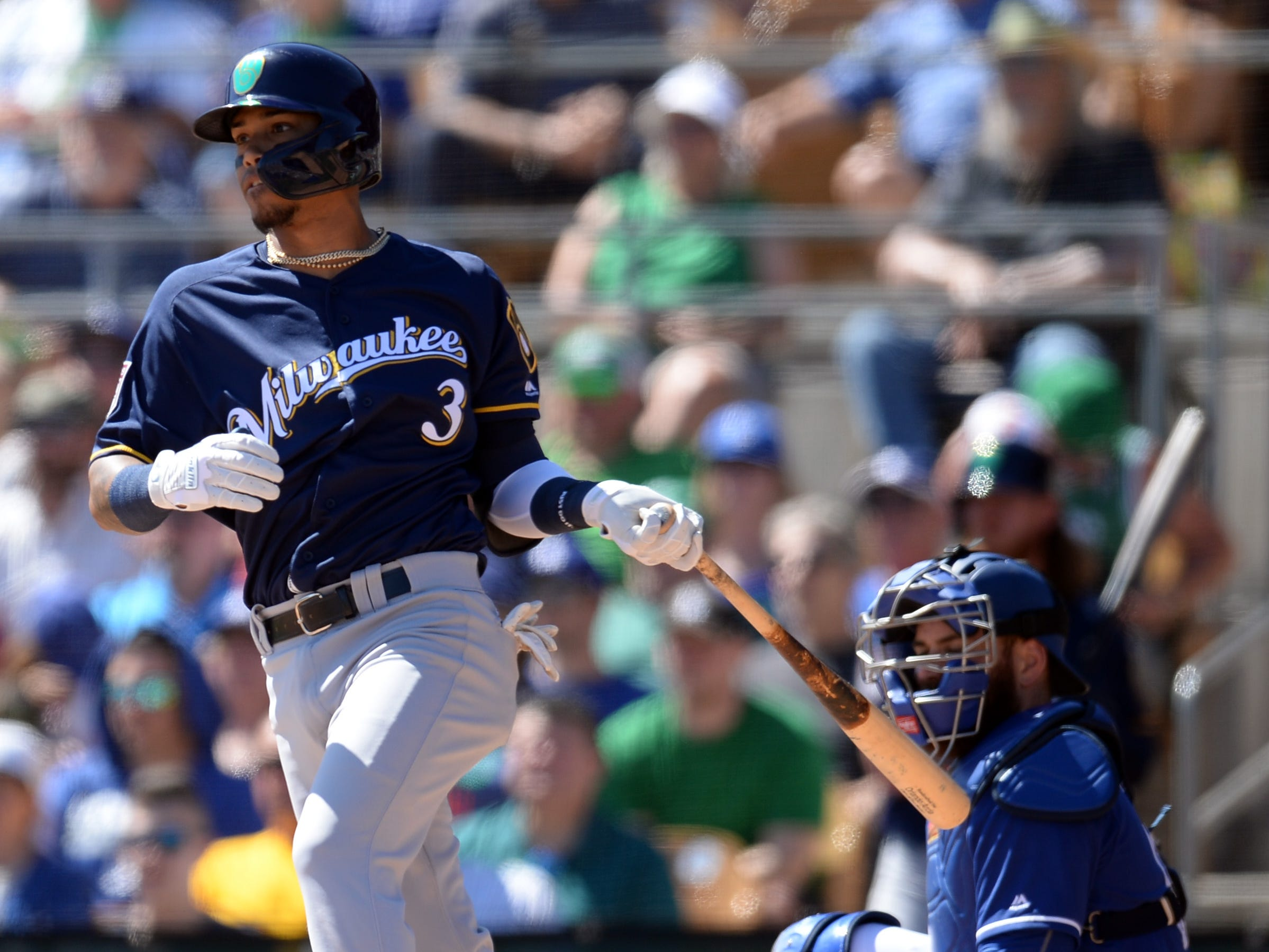 Brewers shortstop Orlando Arcia singles against the Dodgers in the second inning.