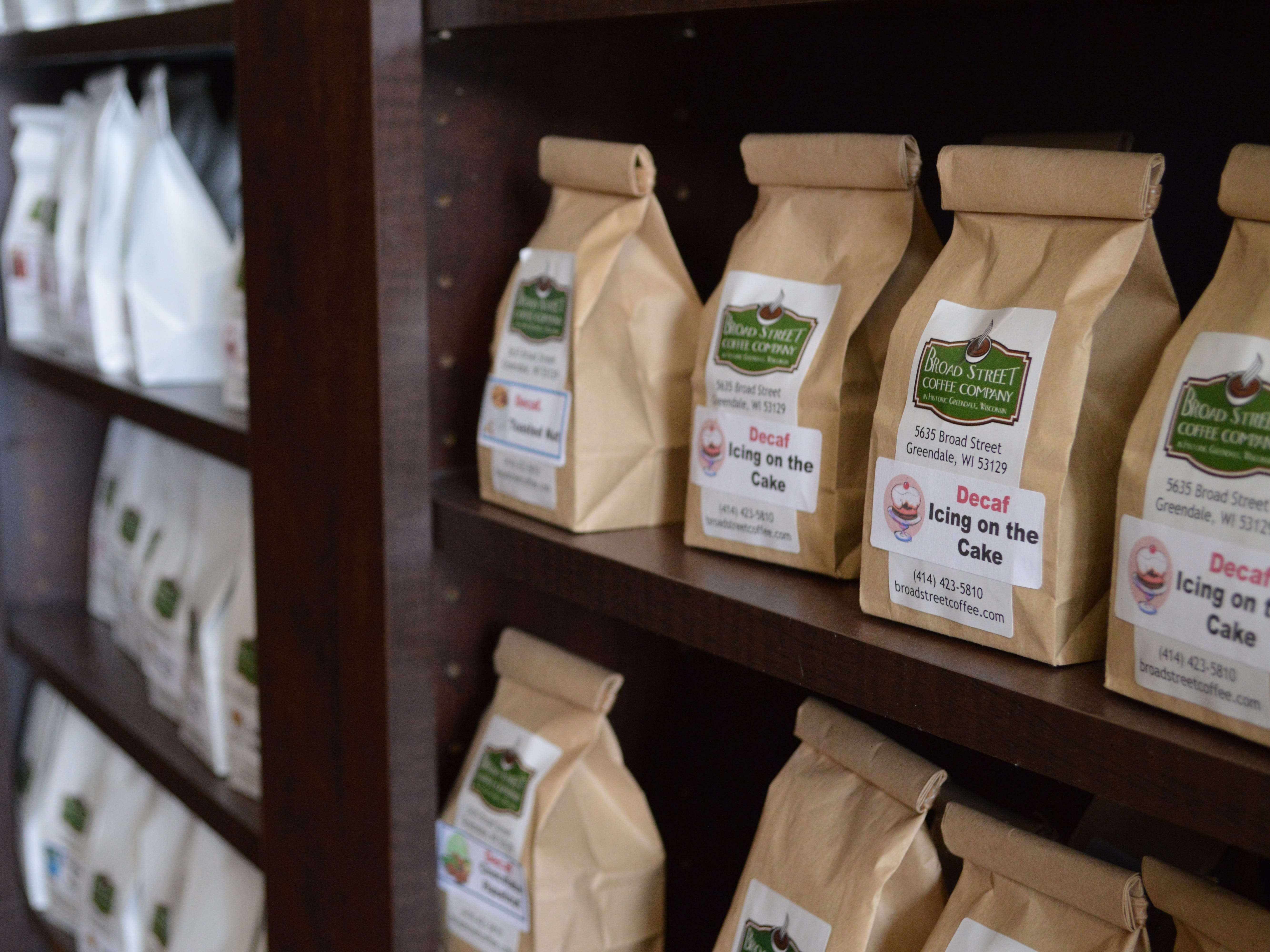 """The shop has a """"wall of flavors"""" with about 20 kinds of packaged flavored coffees."""