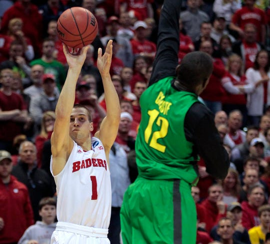 Ben Brust lines up a shot against Oregon in the 2014 NCAA Tournament.