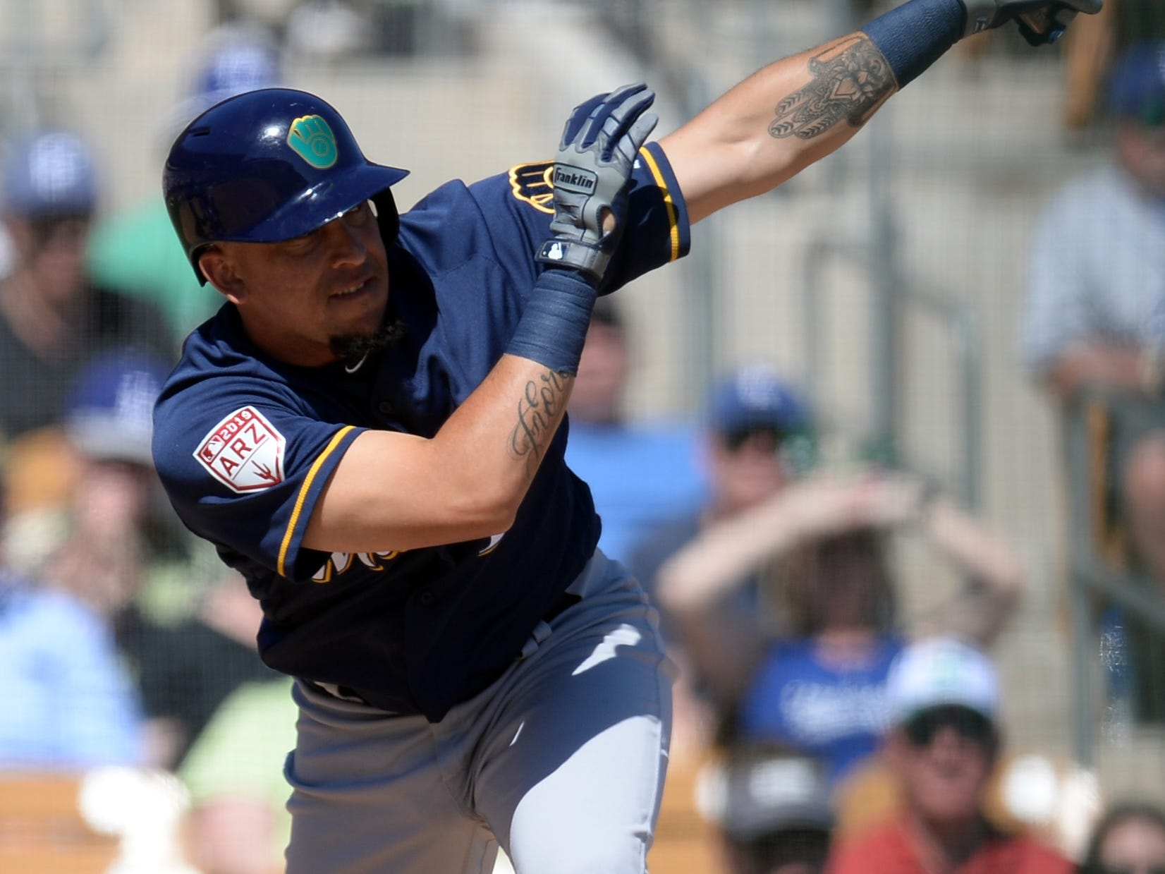 Hernan Perez of the Brewers singles against the Dodgers with two outs in top of the third inning.