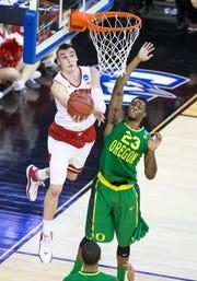 Wisconsin's Sam Dekker puts up a reverse layup against Oregon's Elgin Cook.
