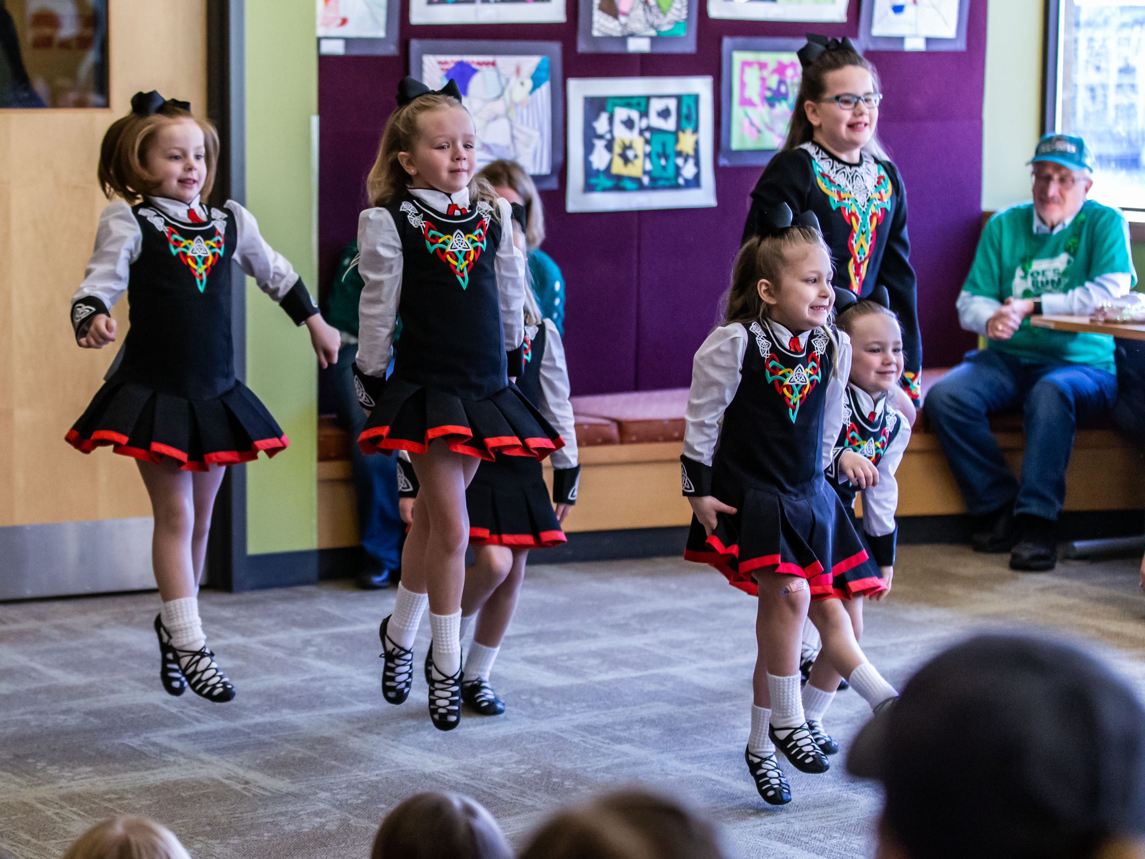 Dancers from the Trinity Academy of Irish Dance perform for visitors at the Waukesha Public Library on Saturday, March 16, 2019.