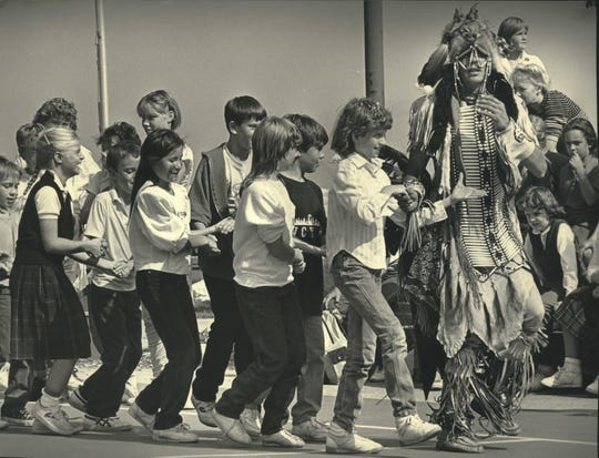 Nick Hockings, a Lac du Flambeau Chippewa, teaches some children an Indian dance during the first Indian Summer Festival at the Summerfest grounds in 1987.