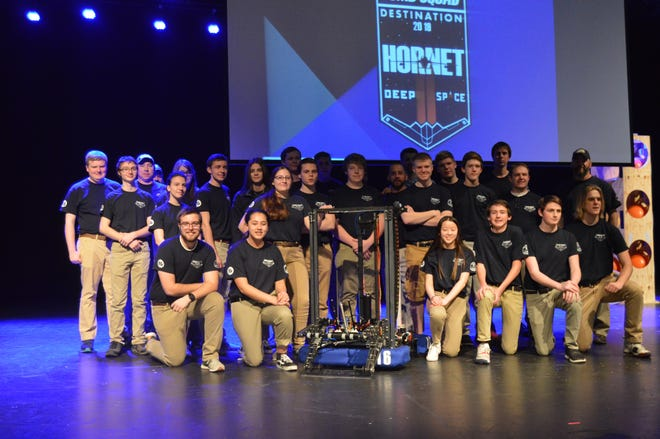 The Mountain Home High School Bomb Squad robotics team poses for a picture at the Rocket City Regionals in Alabama. The team took home a second place overall finish and also took home the Engineering Award for overall best design of a robot.