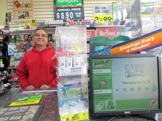 Mehul Shah, owner of Baldwin News Plus in Parsippany, confirms selling a Powerball ticket that won $1 million in the March 16 drawing.