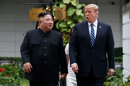 In this Feb. 28, 2019 file photo, President Donald Trump and North Korean leader Kim Jong Un take a walk after their first meeting at the Sofitel Legend Metropole Hanoi hotel, in Hanoi.