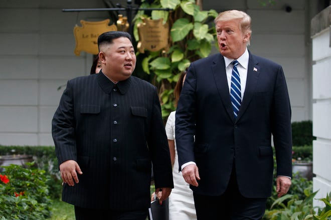 "In this Feb. 28, 2019 file photo, President Donald Trump and North Korean leader Kim Jong Un take a walk after their first meeting at the Sofitel Legend Metropole Hanoi hotel, in Hanoi. John Bolton, President Donald Trump's national security adviser, says North Korean allegations that he and Secretary of State Mike Pompeo created an atmosphere of hostility and mistrust at last month's nuclear summit in Hanoi are ""inaccurate.""  North Korea's Vice Foreign Minister Choe Son Hui recently said that Trump was willing to talk, but was influenced by uncompromising demands by Pompeo and Bolton. She says the ""gangster-like stand of the U.S. will eventually put the situation in danger."""