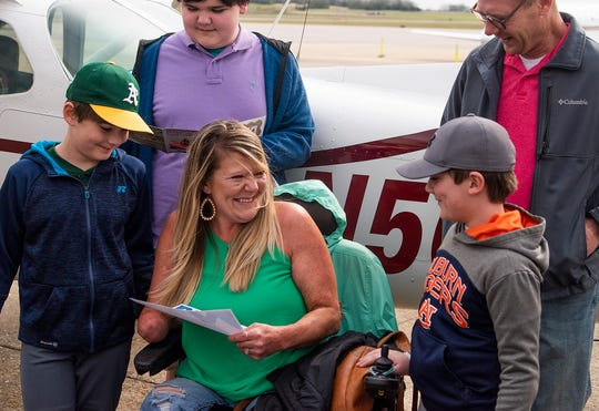 Jessica West, her husband Justin West and their sons Dylan West, Kye West and Reed West react to being given a vacation and summer camp scholarships as they get to fly with the Highland Flying Club out of Montgomery, Ala., on Monday March 18, 2019.