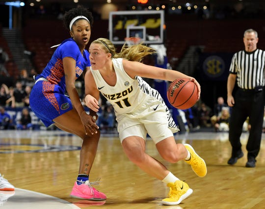 Missouri's Haley Troup (11) drives past Florida's Danielle Rainey during the first half of an NCAA college basketball game at the Southeastern Conference women's tournament, Thursday, March 7, 2019, in Greenville, S.C. (AP Photo/Richard Shiro)