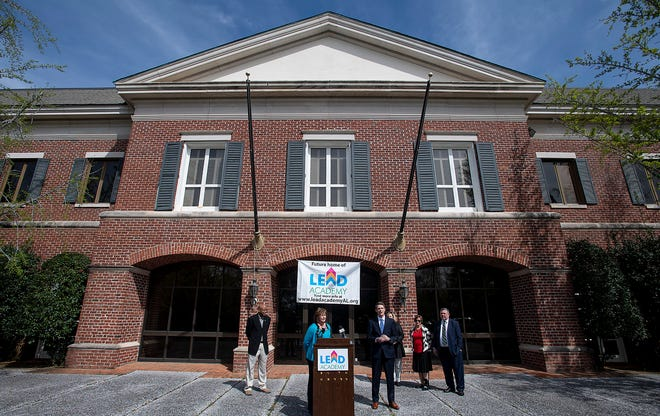 Charlotte Meadows, left, and Ryan Cantrell, of LEAD Academy, hold a press conference at the school's future campus In Montgomery, Ala., on Monday March 18, 2019.