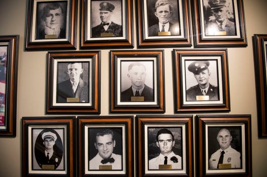 Photos of past firefighters at the Montgomery Fire Department in Montgomery, Ala., on Monday, March 18, 2019.