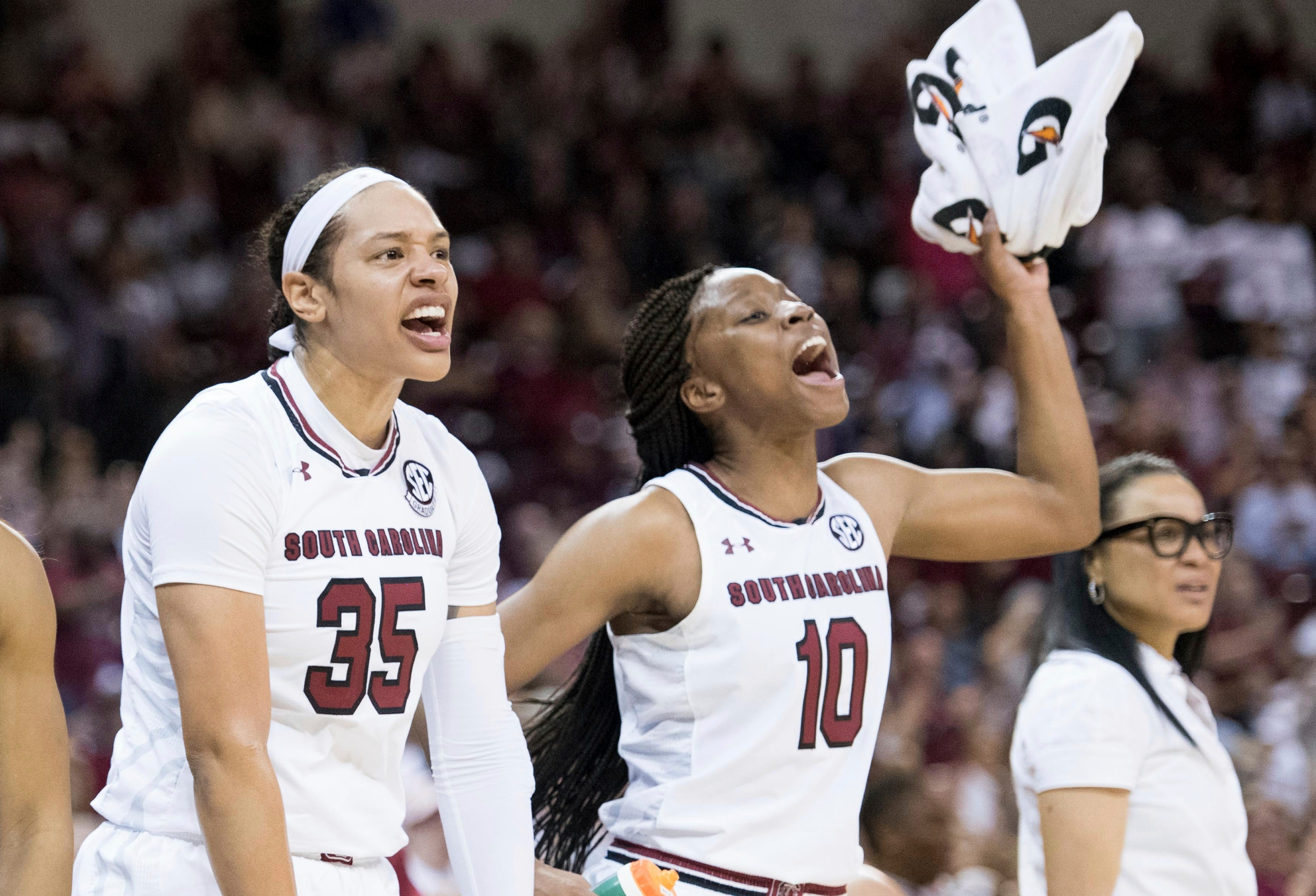 South Carolina guard Te'a Cooper (2), Alexis Jennings (35), and Bianca Jackson (10) celebrate a defensive play during the first half of an NCAA college basketball game against Mississippi State Sunday, March 3, 2019, in Columbia, S.C. (AP Photo/Sean Rayford)