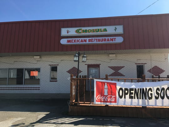 "A sign reading ""Opening Soon"" hangs from space expected to house a Cholula Mexican Restaurant."