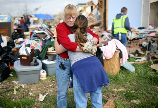 Paulette White hugs Laura Inmon after Inmon's home in the Blackman Community was badly damaged after a tornado in Murfreesboro, Tennessee on Saturday April 11, 2009. (Josh Anderson for The Tennessean)