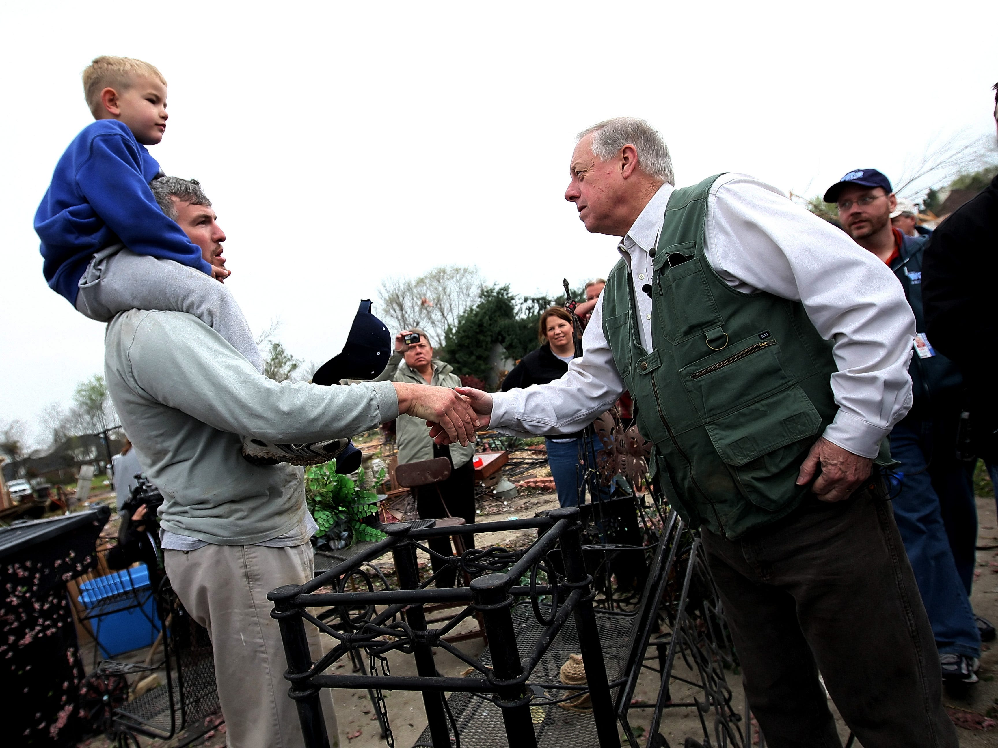 Tennessee Governor Phil Bredesen (right) shakes hands with William Busey and his son Jack Busey, 5, at the site of a home that was damaged by the tornado in Murfreesboro, Tennessee on Saturday April 11, 2009. Busey and his son were helping the home owner clean up. (Josh Anderson for The Tennessean)