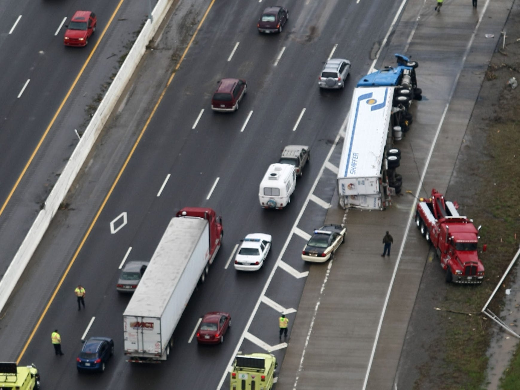 A tractor trailer truck was turned on its side as a result of a tornado along I-24 in Murfreesboro causing traffic problems along the interstate. The tornado cut a 10 mile path through the city.  April 10, 2009 (photo GEORGE WALKER IV / THE TENNESSEAN)
