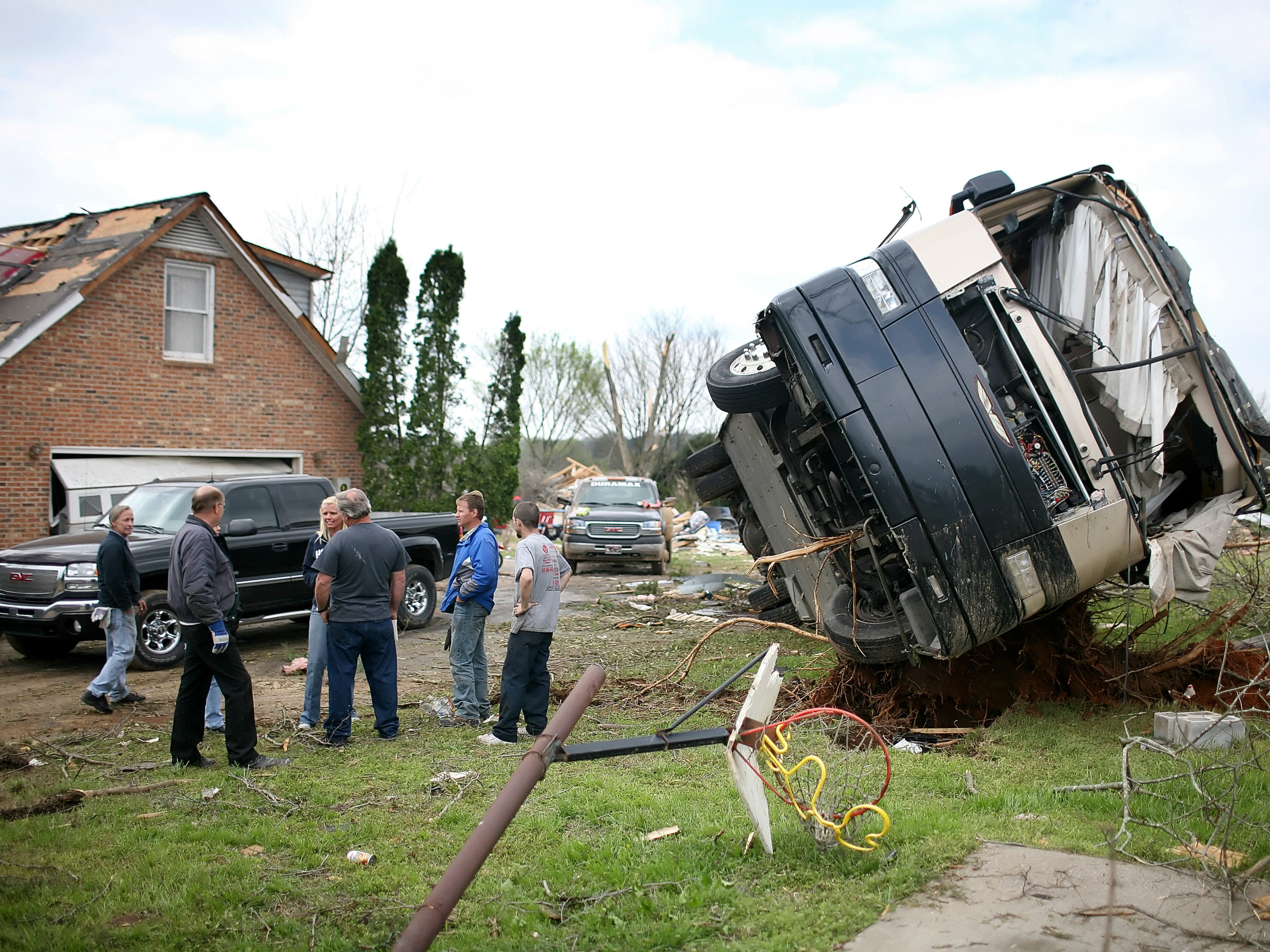 A coach bus sits flipped over at the home of Lorie and Lonnie Cox in the Blackman Community after a tornado in Murfreesboro, Tennessee on Saturday April 11, 2009. (Josh Anderson for The Tennessean)