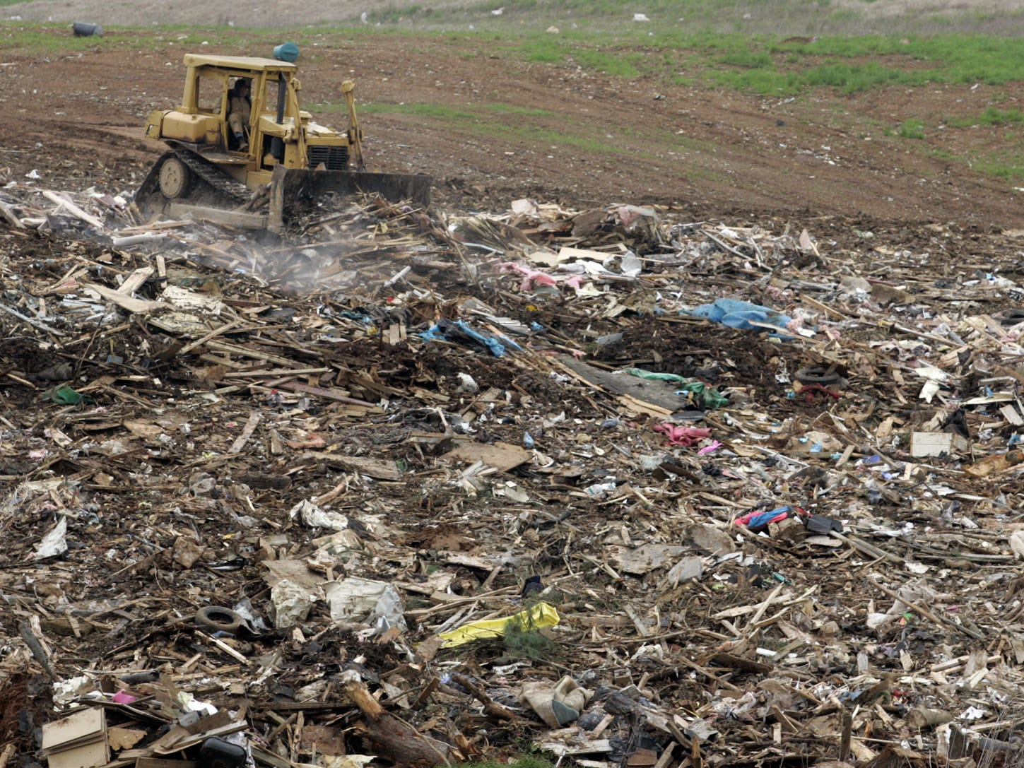 DNJ photo by Aaron Thompson A bulldozer is used to smooth the pile of debris at the Rutherford County Landfill.