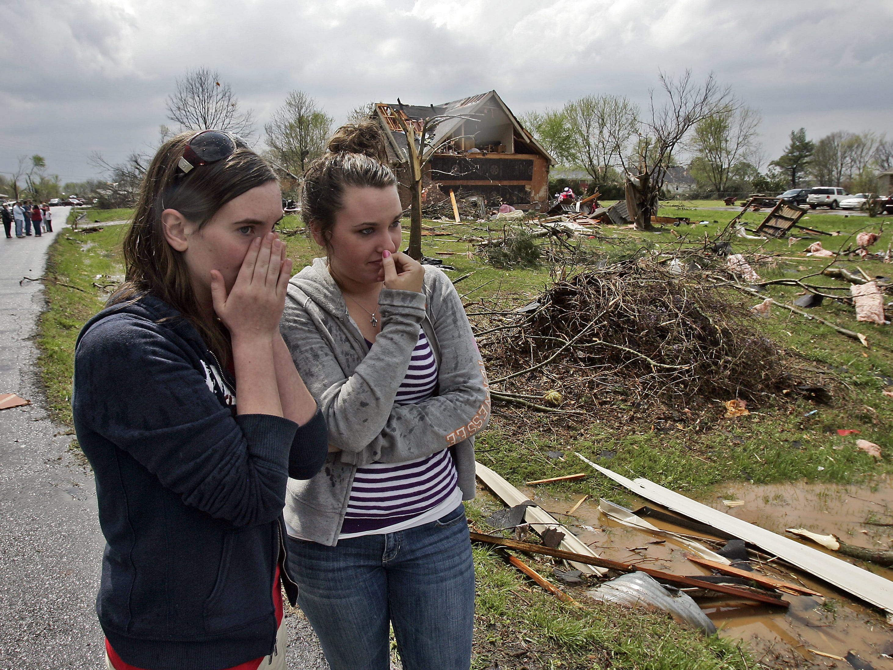 Karolyn Lane, 14, left, and her friend Leslie Hibdon react as they look at tornado damages in the Blackman community in Murfreesboro, Tenn., Friday, April 10, 2009. (JAE S. LEE / THE TENNESSEAN)