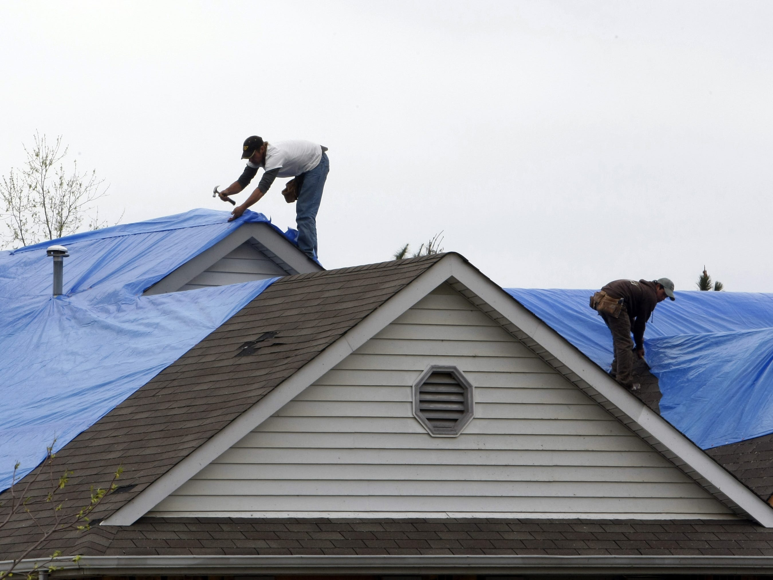 Blue tarps were everywhere as residents clean up and repair a day after a tornado roared through Murfreesboro.