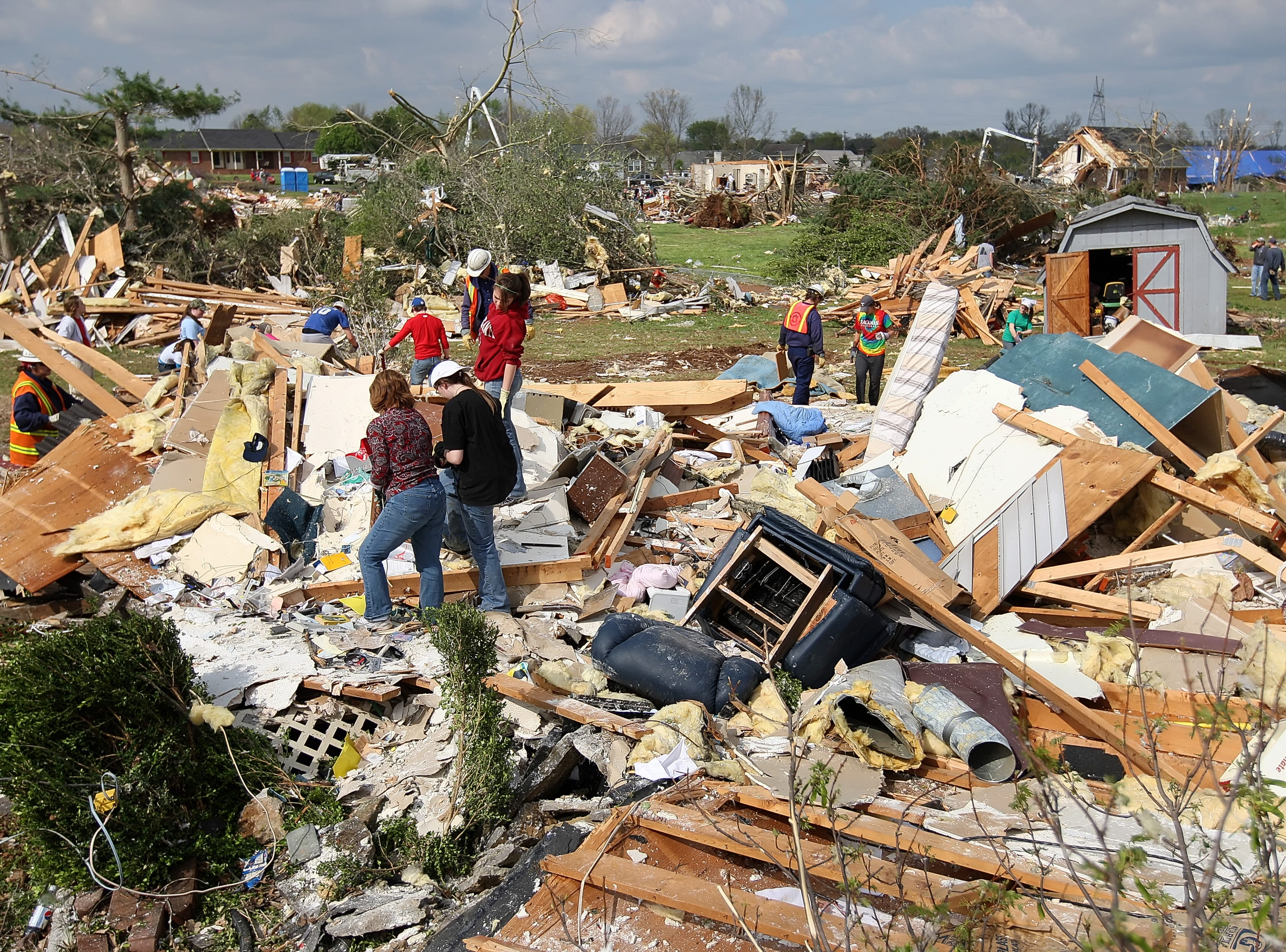 Volunteers and neighbors help to clean up a home which was destroyed in the Blackman Community after a tornado in Murfreesboro, Tennessee on Saturday April 11, 2009. (Josh Anderson for The Tennessean)