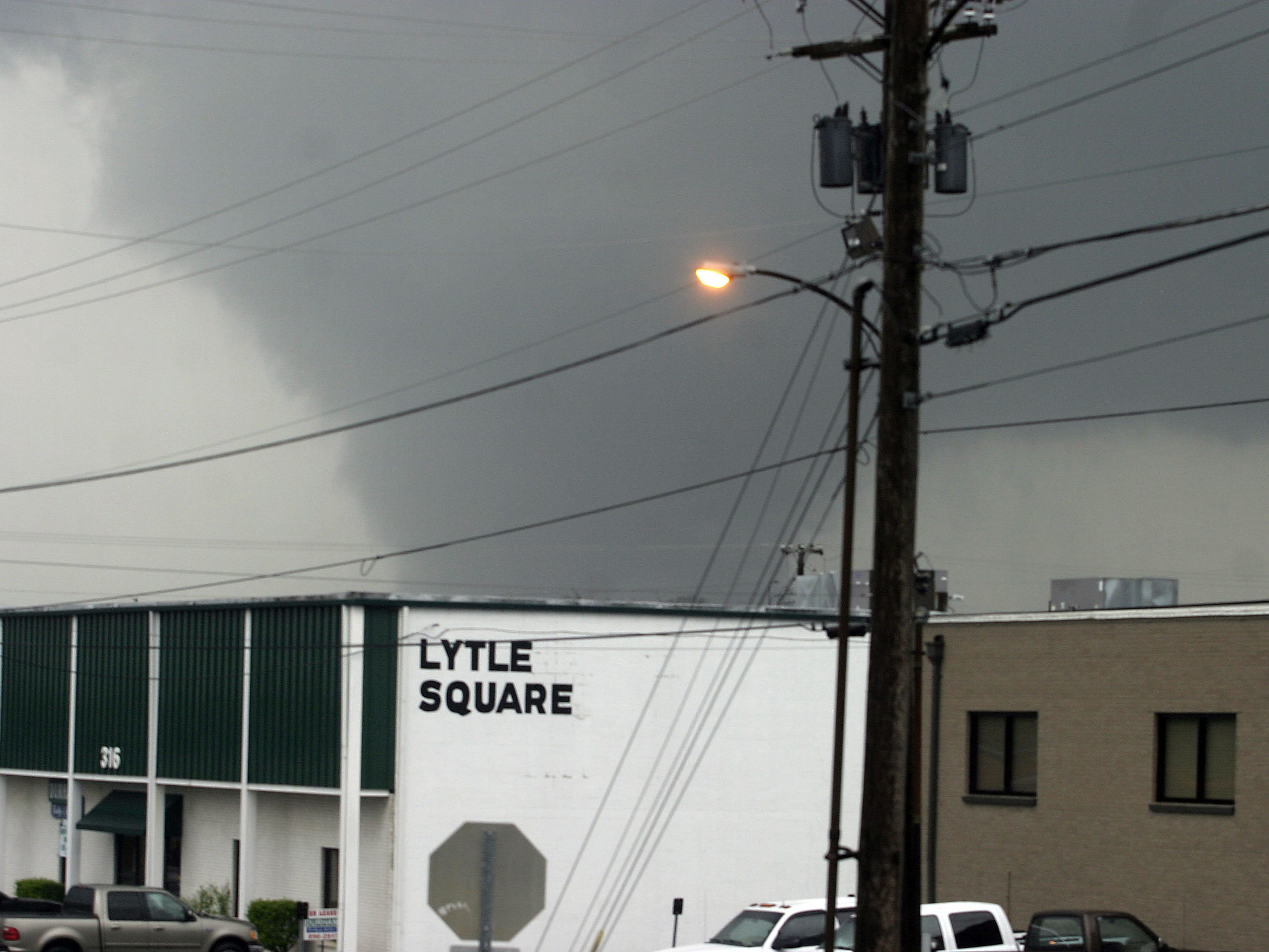 The funnel cloud from the April 10, 2009 tornado makes its way across Southeast Broad Street. This photo was taken from the porch of The Daily News Journal's old office on Walnut Street.