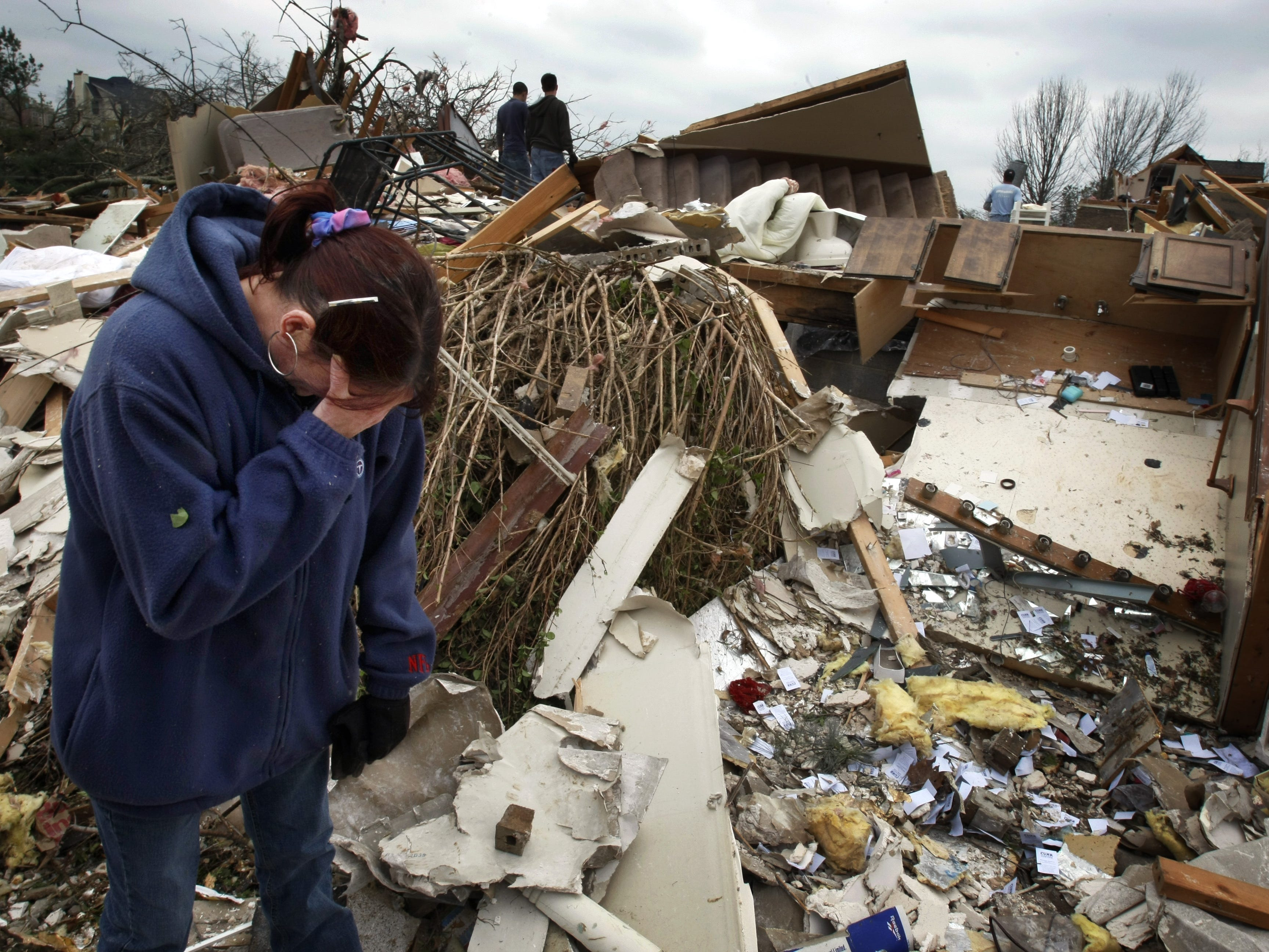 Cheryl Cosco sobs as she pick through the rubble of her home looking for her father's ring that she left on the bathroom vanity. All around her others were picking through what was left, a day after a tornado roared through Murfreesboro.