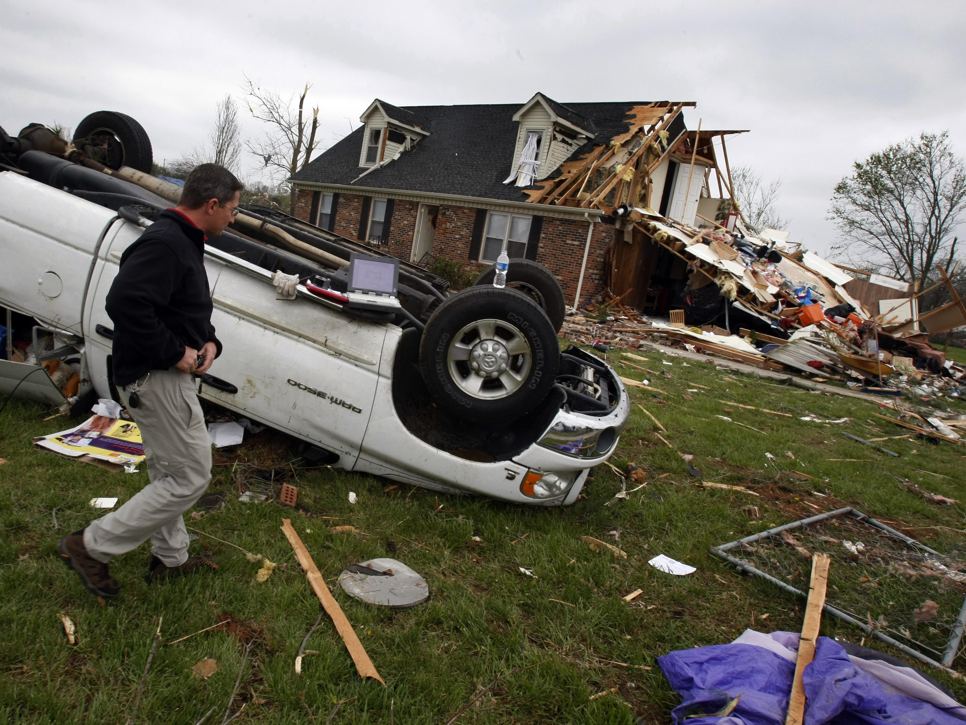 Tony Jones, an apraiser for Travelers Insurance, makes an examination of the damage a day after a tornado roared through Murfreesboro.