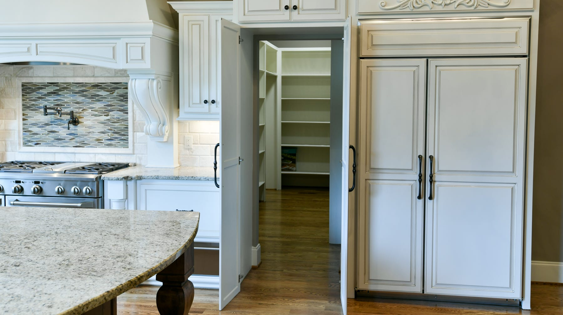 The storm shelter might be hidden inside the pantry, as in this home by Pettis Builders.