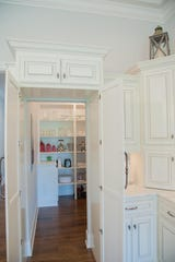 Here is another example of a storm shelter designed into the pantry by Pettis Builders.