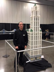 Jonathan Lopes with his 8-foot high Lego Woolworth building that will be part of the BrickUniverse Lego Fan Convention in Wilson County, March 30-31.