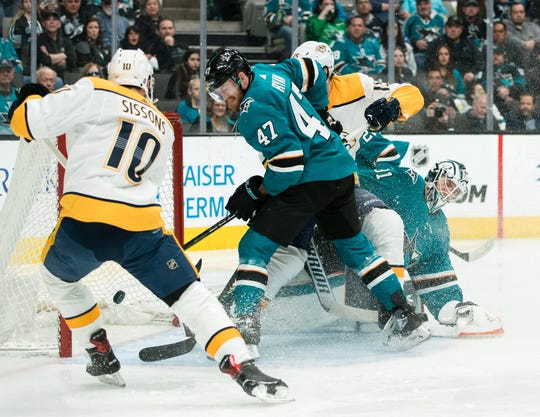 Predators center Colton Sissons (10) shoots and scores a goal against the Sharks on Saturday.
