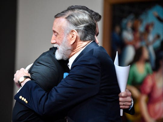 Honoree Ray Stevens is hugged by Bill Cody after his name was announced as one of the Country Music Hall of Fame's 2019 inductees March 18, 2019.