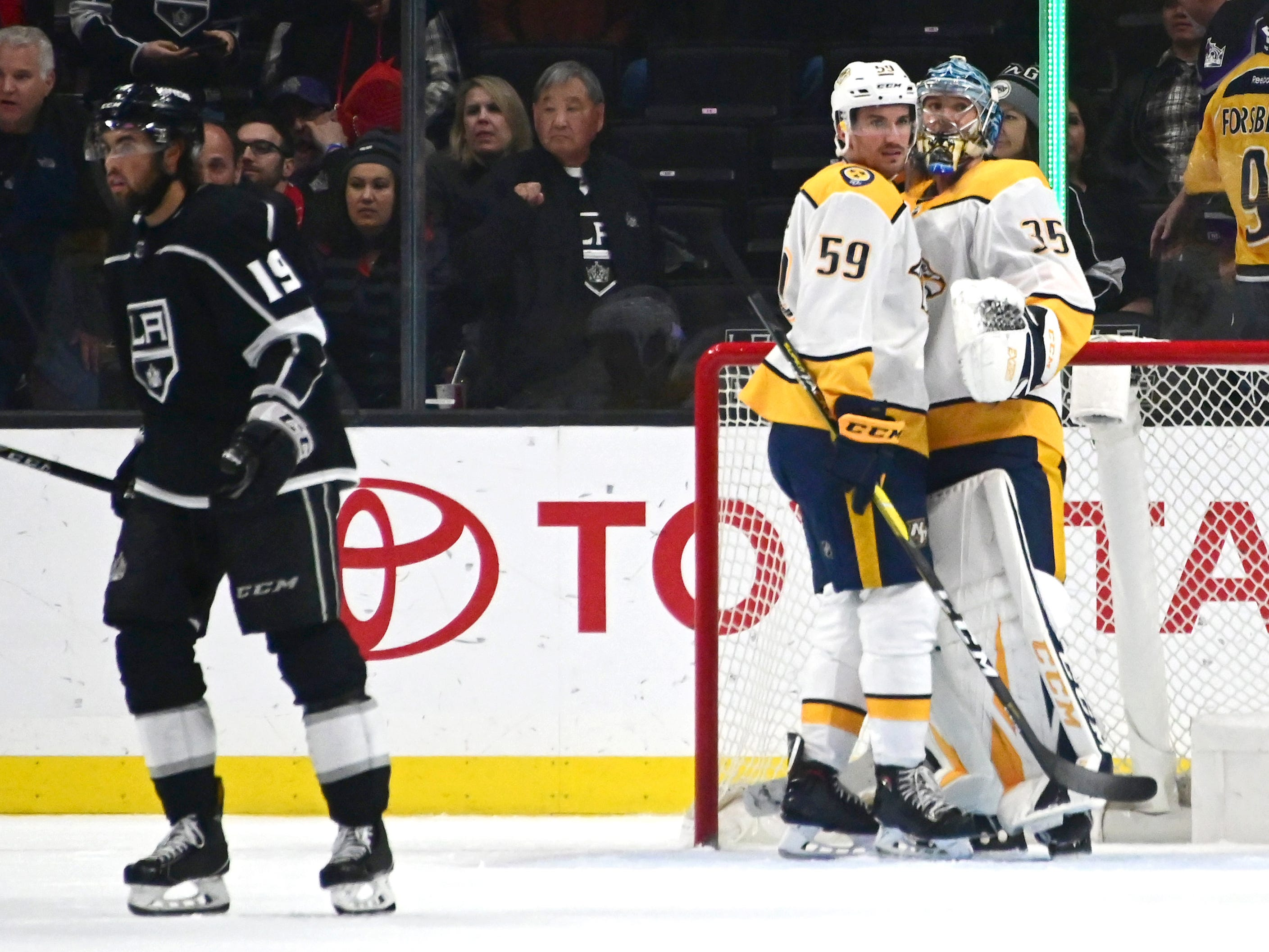 Mar 14, 2019: Predators 3, Kings 1 -- Nashville Predators goaltender Pekka Rinne (35) and defenseman Roman Josi (59) embrace at the end of the game against the Los Angeles Kings at Staples Center.