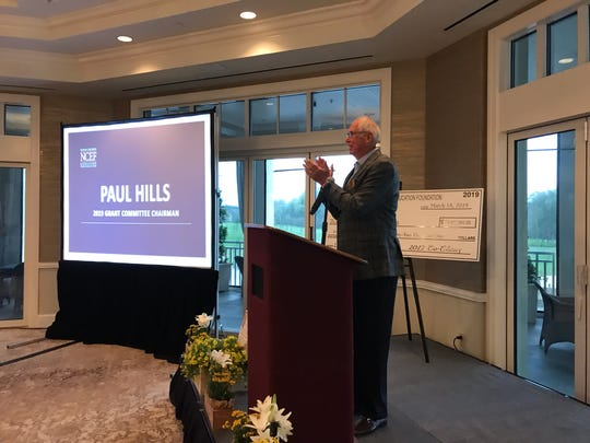 Paul Hills, chairman of the 2018-19 Naples Children & Education Foundation Grant Committee, speaks at the Bay Colony Golf Club on Monday, March 18, 2019.