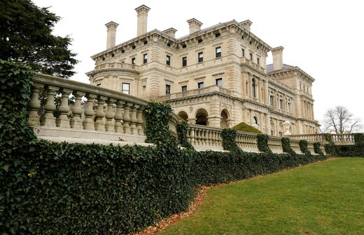 Ivy is attached to a railing at The Breakers mansion, Monday, Dec. 1, 2014, in Newport, R.I. A divisive plan to build a welcome center at The Breakers mansion in Newport is heading for a final review with the city's zoning board set to hold hearings Monday and Tuesday. The Breakers is Newport's most famous mansion and was built in the 1890s by the Vanderbilt family. (AP Photo/Steven Senne)