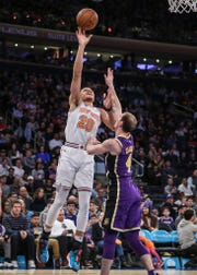 New York Knicks forward Kevin Knox (20) puts up a shot in the fourth quarter against the Los Angeles Lakers at Madison Square Garden.