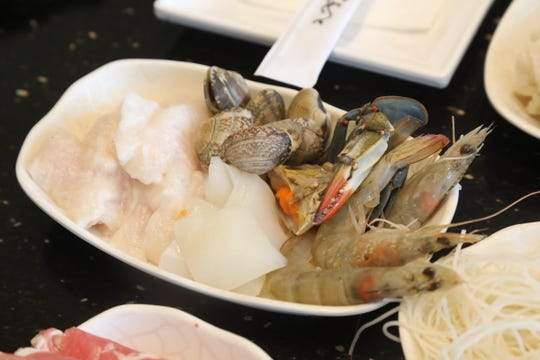 Seafood that is put into a hot broth at the dining table of V-Yan Hot Pot and BBQ.