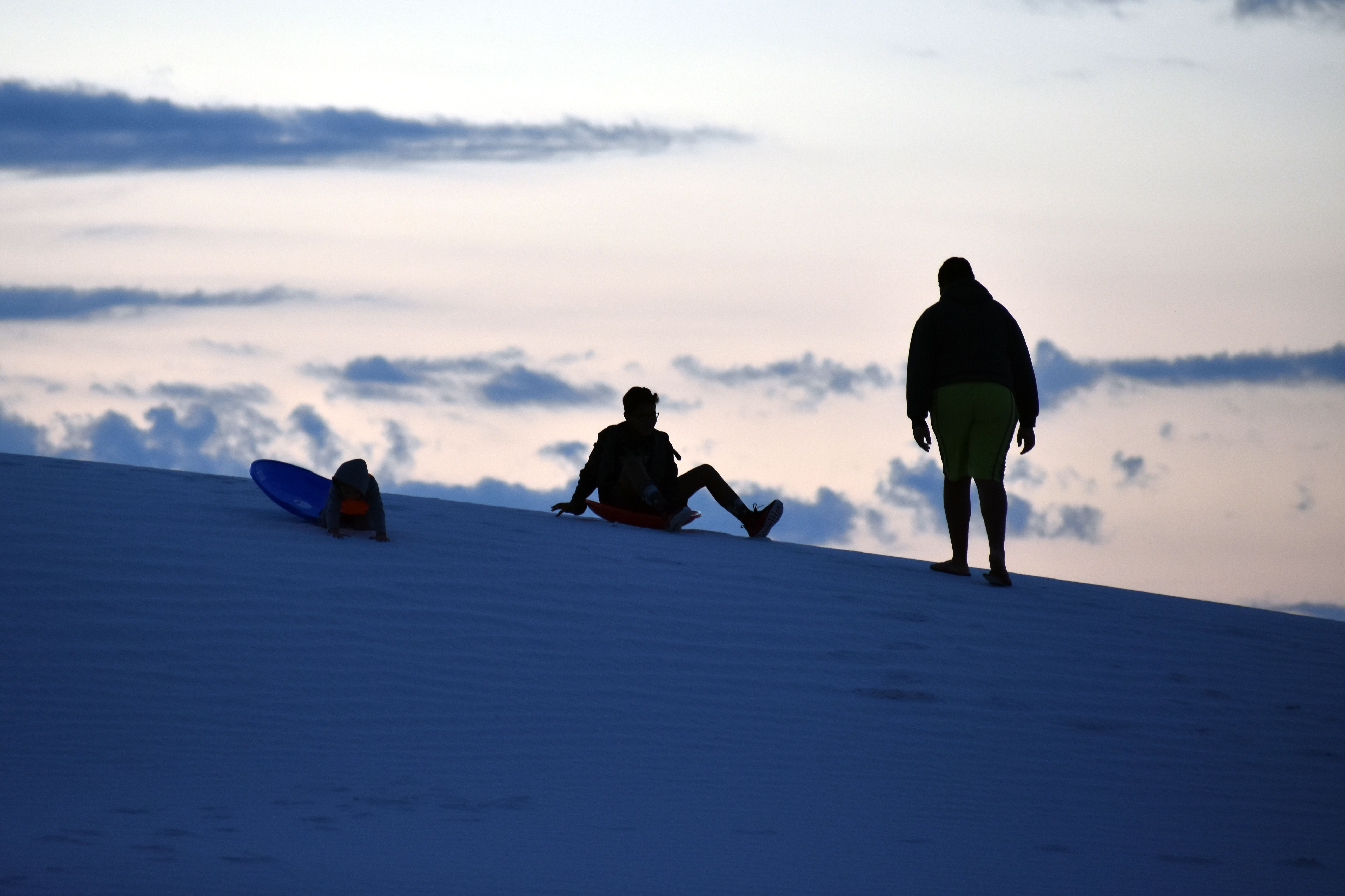 White Sands National Monument visitors enjoy the gypsum sand dunes in 2017.