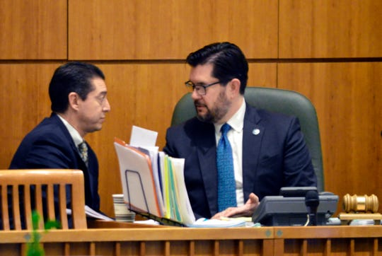 New Mexico Sen. John Sapien, D-Bernalillo, left, meets with Democratic House Speaker Brian Egolf on the House floor on Friday, March 15, 2019 in Santa Fe, N.M. The Democratic-controlled New Mexico Legislature ended Saturday, March 16, 2019, after passing bills to increase education spending and create an independent ethics commission.
