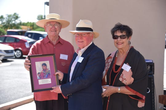 Dr. Kent Jacobs, center, receives the 2018 Papen Family Award on behalf of himself and his wife Sallie Ritter Jacobs. The award was presented by Glen Cutter, left, and Sally Cutter, right.