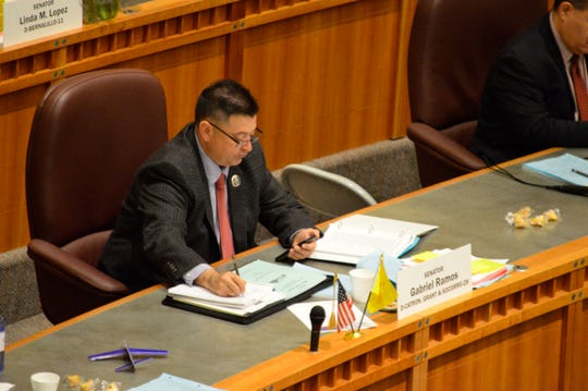 New Mexico Sen. Gabriel Ramos, D-Silver City, takes notes on a bill on the Senate floor on Saturday, March 16, 2019 in Santa Fe, N.M. The Democratic-controlled New Mexico Legislature ended Saturday, March 16, 2019, after passing bills to increase education spending and create an independent ethics commission.