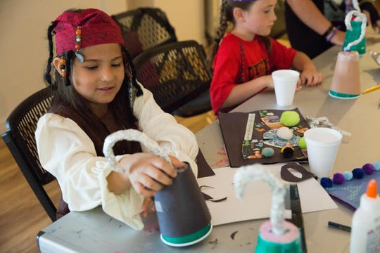 "In this file photo, Isabella Montoya, 8, dressed as Captain Jack Sparrow from ""Pirates of the Caribbean,"" puts the finishing touches on her pirate hook during a spring break camp, put on by the city of Las Cruces Friday, March 24, 2017, at the Branigan Cultural Center."