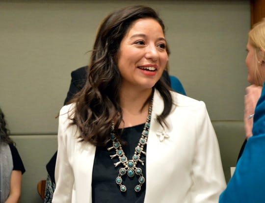 In this Jan. 15, 2019 file photo, New Mexico state Rep. Andrea Romero, D-Santa Fe, a freshman lawmaker, talks to fellow House members before the start of the New Mexico Legislative session in Santa Fe, N.M. Romero said fellow freshmen were disappointed that moderate Senate Democrats hindered some of their liberal initiatives during the New Mexico Legislative session which ended Saturday, March 16.