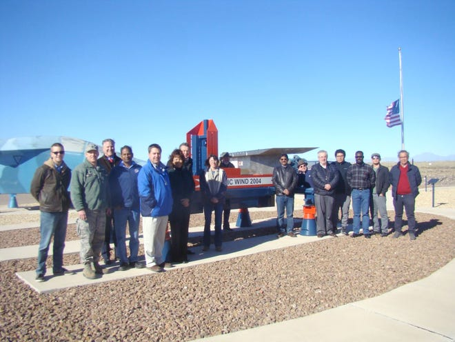 The 704th Test Group's Holloman High Speed Test Track, operated by the 846th Test Squadron, recently hosted a group of scientists and engineers from the University of Texas at El Paso (UTEP) at Holloman Air Force Base, New Mexico. The 704th Test Group leadership and staff from UTEP used this visit as an opportunity to discuss ways the two groups could collaborate. Pictured from left are Bryan Sinkovec, Lt. Col Mathew Wroten, Commander 846 TS; Robert Kirken, dean, College of Science at UTEP; Vinod Kumar; Robert Edmonds; Theresa Maldonado, dean, College of Engineering at UTEP; Bob Currey; Michelle Zeisset; Gregory Mckinzey; Ramana Chintalapalle; Thomas Gill; Carlos Ferregut; Arturo Rodriguez; Richard Adansi; Jose Terrazas; and Eduardo Quinonez-Rico.