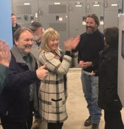 Lyon Township Supervisor John Dolan and Treasurer Patricia Carcone celebrate as the new Woodwind water treatment plant's filtration system is turned on March 18, 2019.