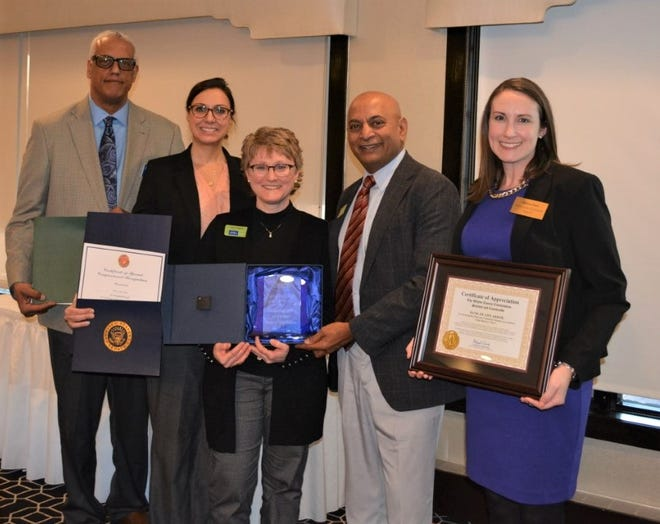 Bank of Ann Arbor was honored as Large Business of the Year. Pictured (from left), City Commissioner Tony Sebastian, State Senator Dayna Polehanki, Bank of Ann Arbor's Kris Mayer and Satish Jasti and County Commissioner Melissa Daub.
